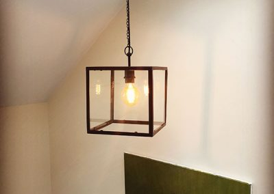 Square cage light above stairs